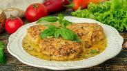 Фото рецепта Куриные тефтели с рисом в сметанном соусе
