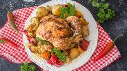 Фото рецепта Цыплёнок целиком запеченный с овощами