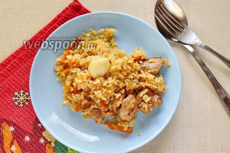 Фото Плов со свининой и белыми грибами на сковороде