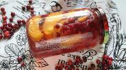 Фото рецепта Компот из персиков с клюквой