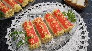 Фото рецепта Закуска из плавленого сыра в крабовых палочках
